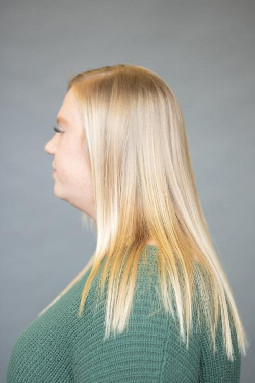 Blonde guest before receiving Vomor extensions for thicker fuller hair