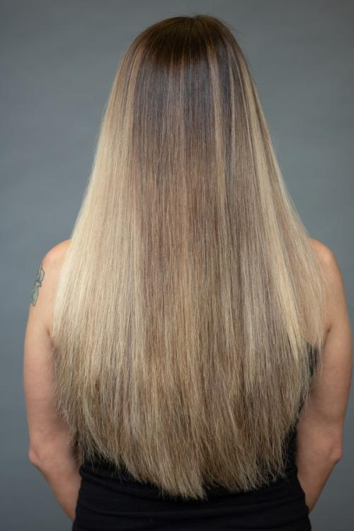 Blonde guest receiving Vomor hair extensions for thicker fuller hair